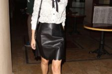 With white blouse, black tie, bag and mid calf boots