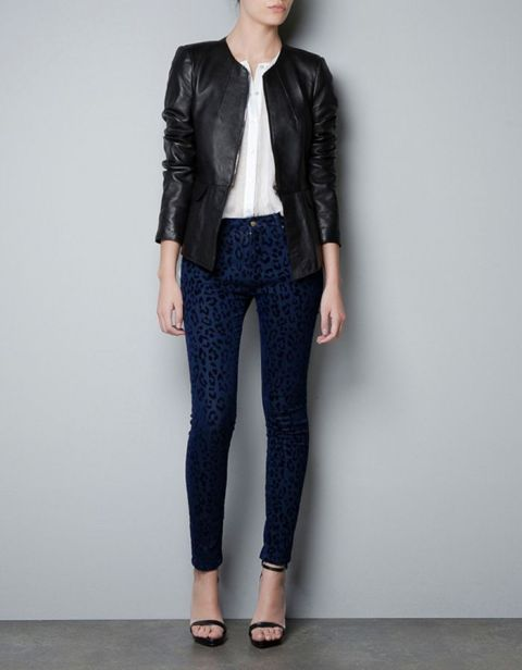 With white blouse, navy blue and black printed skinny pants and ankle strap shoes