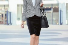 With white blouse, printed blazer, black bag and black shoes