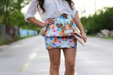 With white button down shirt, beige clutch and orange high heels