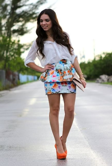 With white button down shirt, beige clutch and orange high heels