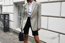 With white button down shirt, black mini bag and black flat shoes