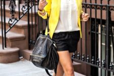 With white button down shirt, yellow blazer, black leather bag and yellow and green shoes