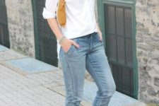 With white button down shirt, yellow clutch and black pumps