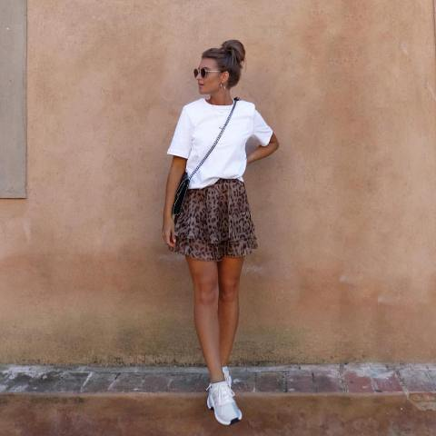 With white loose t shirt, crossbody bag and shoes