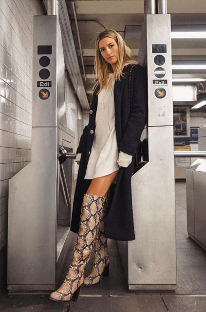 With white mini dress and black midi coat