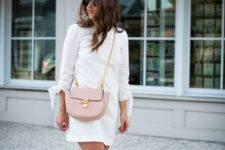 With white mini dress and pale pink flat shoes