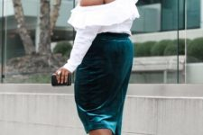 With white one shoulder ruffled blouse, mini clutch and black high heels