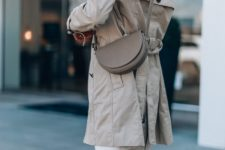 With white pants and gray trench coat