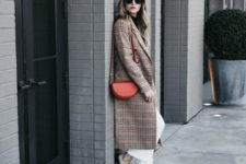 With white pants, checked midi coat and black mules