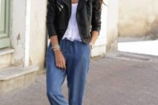 With white ruffle blouse, black leather jacket and white shoes