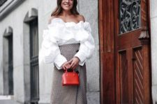 With white ruffled blouse, two colored shoes and red mini bag