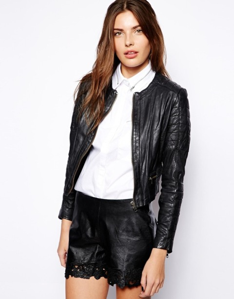 With white shirt and black leather shorts