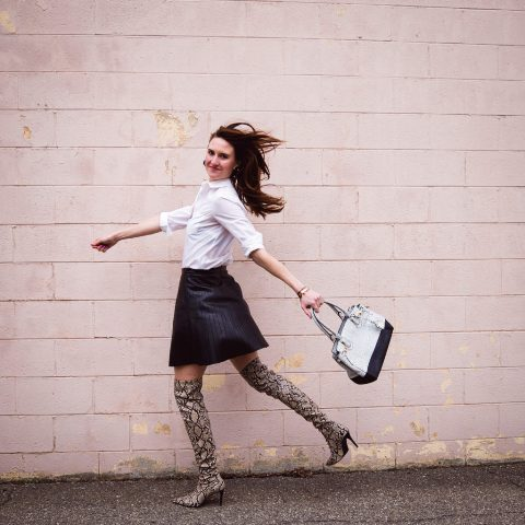 With white shirt, black mini skirt and two colored bag
