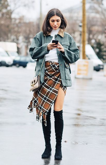 With white shirt, blue jacket, chain strap bag and black over the knee boots