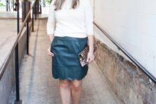 With white shirt, leopard clutch and ankle strap shoes