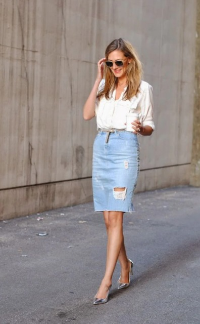With white shirt, sunglasses and silver pumps