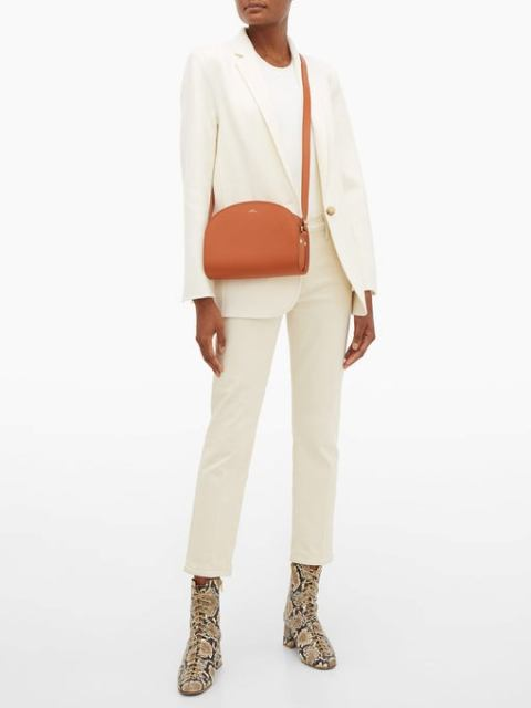With white shirt, white blazer, white cropped pants and printed boots