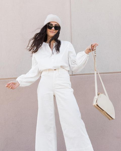 With white shirt, white high waisted pants and hat