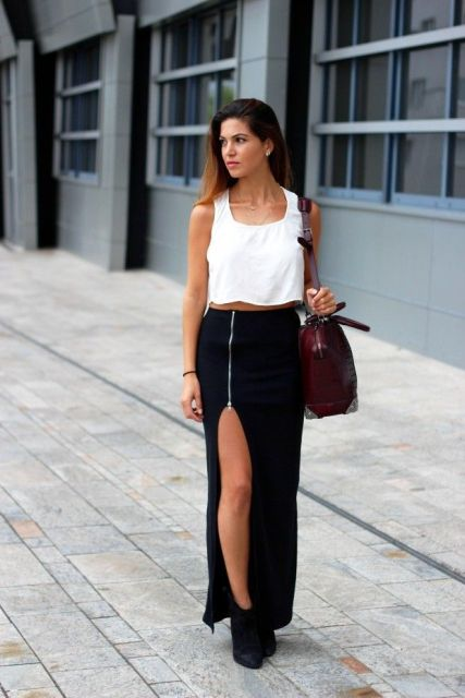 With white sleeveless top, marsala bag and black ankle boots