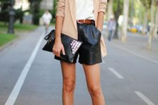 With white t-shirt, beige blazer, metallic clutch and two colored high heels