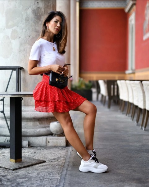With white t shirt, black bag and white sneakers
