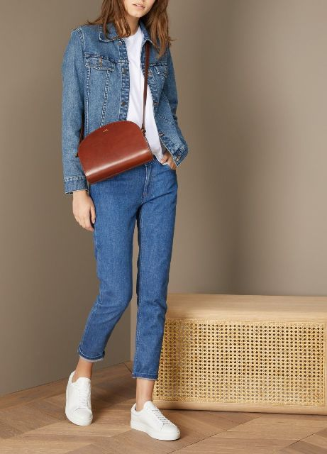 With white t-shirt, denim jacket, cropped jeans and white sneakers