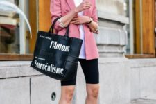 With white t-shirt, labeled tote bag and sneakers
