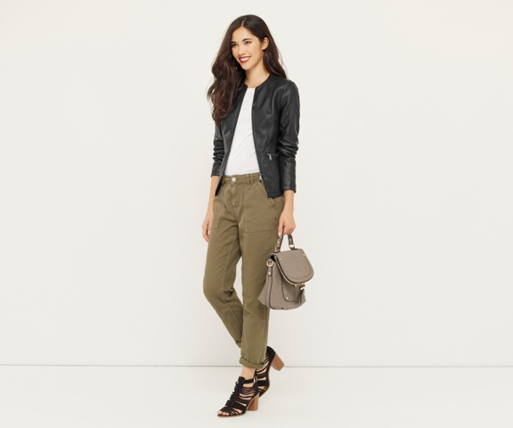 With white t-shirt, leather backpack, olive geen pants and heels
