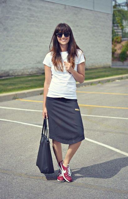 With white t shirt, tote bag and red and white sneakers