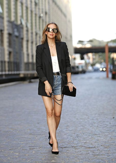 With white top, black blazer, clutch and pumps