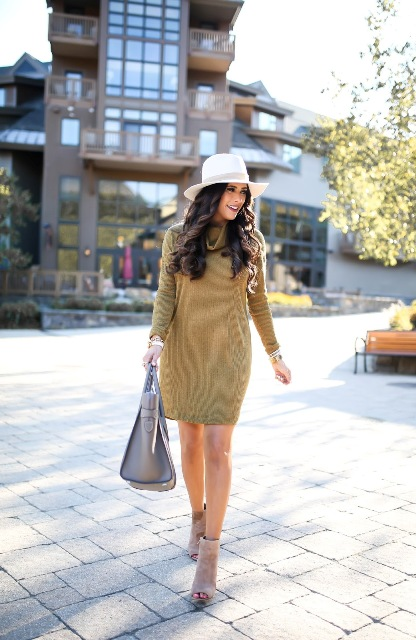 With white wide brim hat, gray tote bag and cutout boots