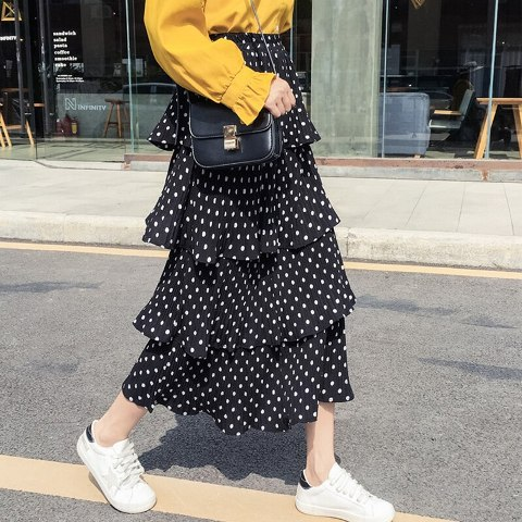 With yellow blouse, chain strap bag and white sneakers
