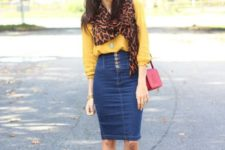 With yellow blouse, leopard scarf, red bag and beige ankle boots