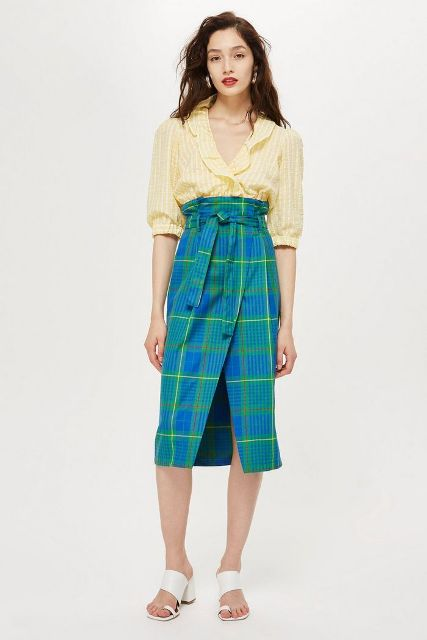 With yellow striped blouse and white mules