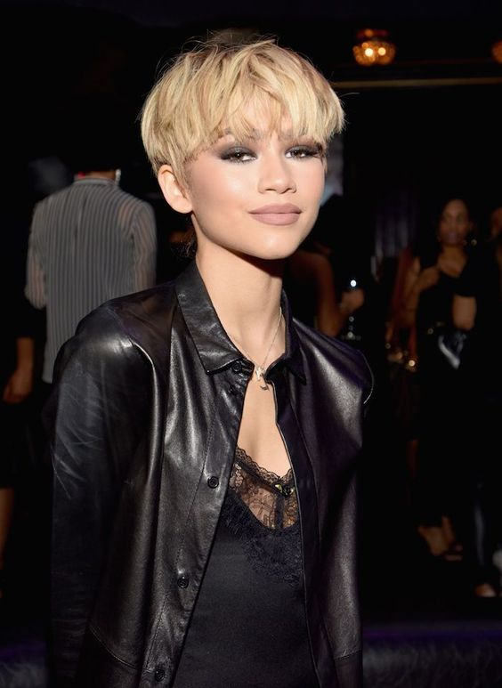 Zendaya rocking a textural blonde mushroom haircut for a bold and very sexy look