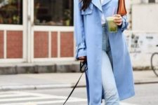 a blue trench, light blue ripped jeans, white slippers and a white tee plus a clutch