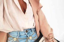 a blush shirt, blue high waisted jeans, a mauve kimono, a layered gold chain belt
