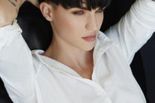a bowl haircut done in a dark chocolate shade to contrast light-colored eyes and create a bold look