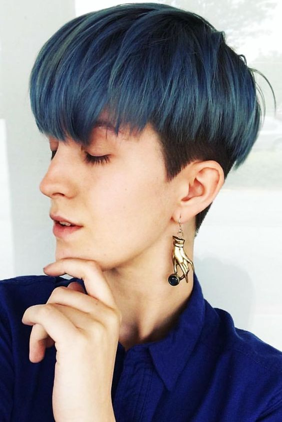 a bowl haircut done in bold blue is a trendy and edgy idea that will make you stand out a lot