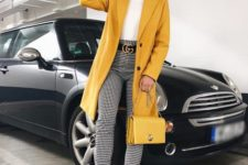a chic outfit with checked pants, a white teee, white sneakers, a sunny yellow trench and a matching bag