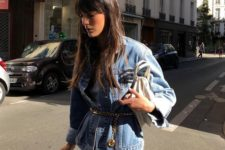 a double denim look in blue with a gold chain belt for a trendy touch to the outfit