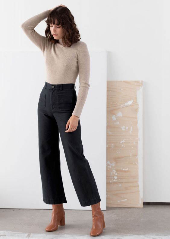 a neutral long sleeve top, black high waisted trousers, brown square toe booties