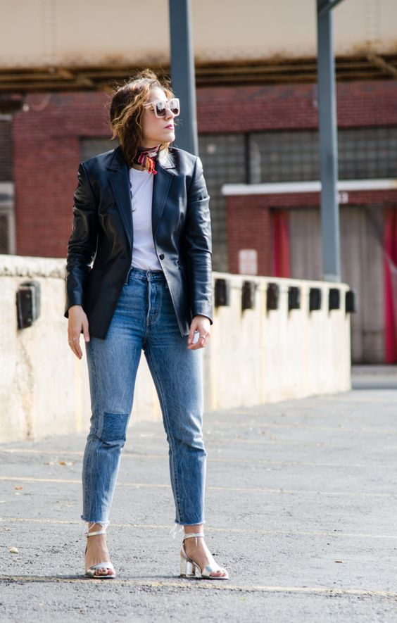 a simple spring look with a white tee, blue skinnies, silver shoes and a black leather blazer