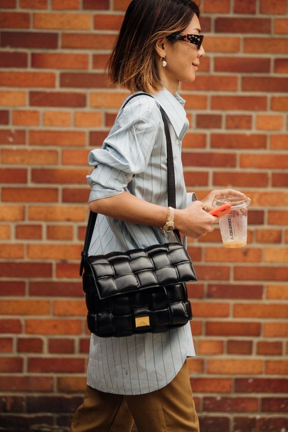 a single black woven leather bag will easily spruce up any outfit, even the simplest one