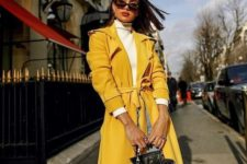a statement sunny yellow trench and a matching bag make up a super stylish combo