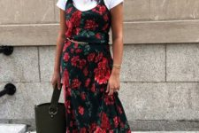 a summer outfit with a white tee, a dark floral slip midi dress, black lace up shoes, a black bucket bag and a gold chain belt