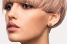 a trendy bowl cut done in a soft pastel pink shade will make your look ultimately trendy