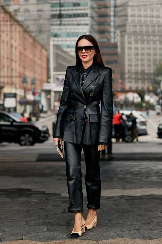 a trendy look with a black leather blazer and pants, a black shirt and two tone shoes