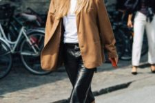a white tee, a black midi leather skirt, an oversized camel blazer ad black wire square toe shoes